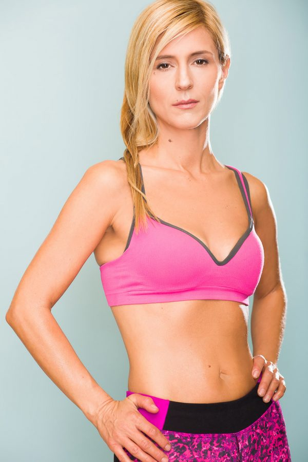 Blonde Fitness modeling pink sports bra