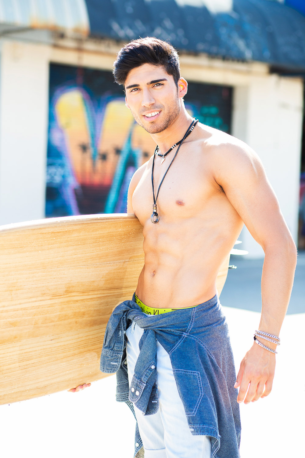 Shirtless Latino Male Model on Venice Boardwalk holding Surfboard