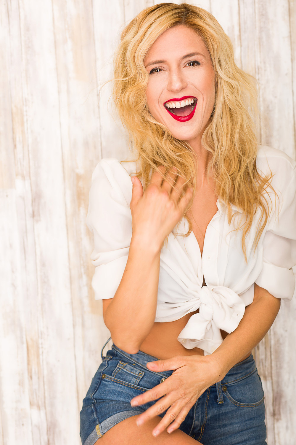Harmony Blossom laughing and modeling in daisy dukes