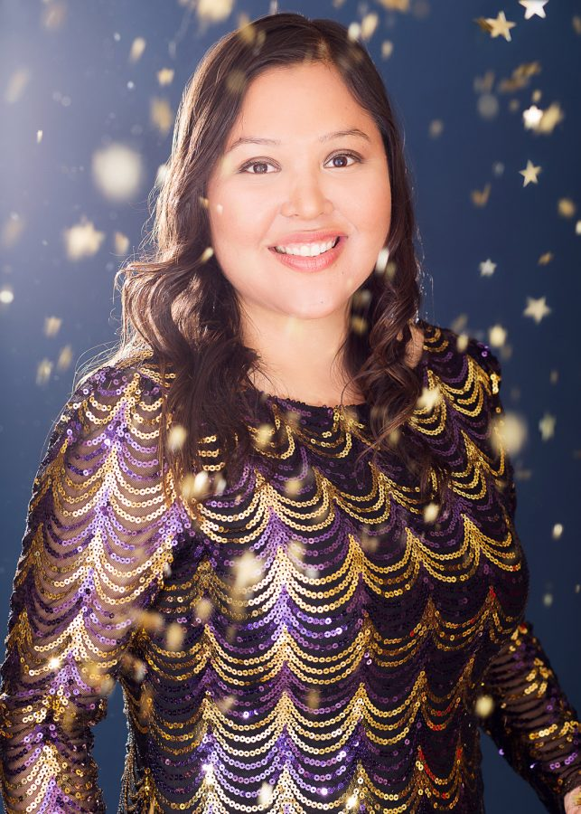 Woman in new years sequin dress with confetti thrown